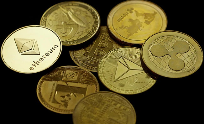 Cryptocurrency coins representing Ethereum , XRP etc.