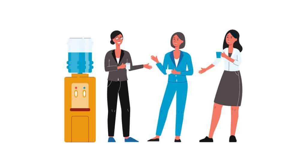 girls talking around water cooler